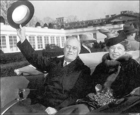 FDR waves his hat to the camera.