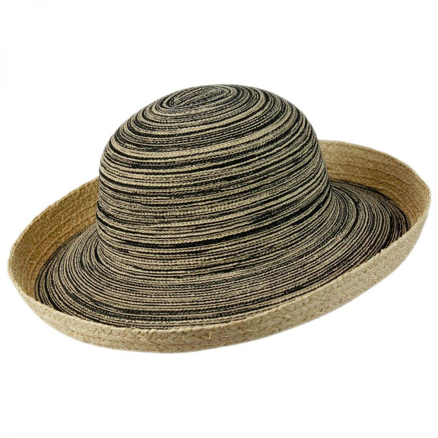 """— floppy straw hat (This time, a hat with circular """"ridges"""" along the brim would work best. We got this hat from Forever 21) — fabric paint — paint brushes — scissors. Instructions: 1. Remove any trim from the hat. 2. Paint stripes around the brim of the hat and continue to the top of the hat."""